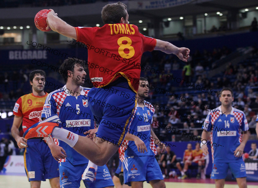 BELGRADE, SERBIA - JANUARY 29:  Victor Tomas (L) of Spain jumps to shoot during the Men's European Handball Championship 2012 Bronze medal match between Croatia and Spain at Arena Hall on January 29, 2012 in Belgrade, Serbia. (Photo by Srdjan Stevanovic/Starsportphoto.com ©)
