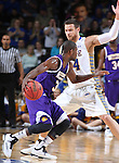 SIOUX FALLS, SD - MARCH 7: Garret Covington #31 of Western Illinois drives as Cody Larson #34 of South Dakota State defends in the first half of the first round of the men's Summit League Championship Tournament game Saturday evening at the Denny Sanford Premier Center in Sioux Falls, SD. (Photo by Dick Carlson/Inertia)