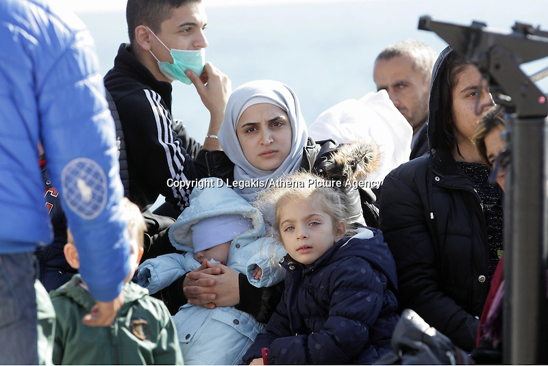 Pictured: A young mother clutrching her young baby Thursday 27 November 2014<br /> Re: One of the largest refugee boats in recent months has disembarked refugees in Ierapetra, Crete. The freighter Baris, carrying 700 people thought to be from Syria and Afghanistan, is being towed by a Greek frigate.<br /> Officials and Red Cross volunteers prepared an indoor basketball stadium as interim shelter in the southern Cretan port town of Ierapetra on Wednesday ahead of the migrants' expected arrival.<br /> Greek officials said the Baris, which lost propulsion on Tuesday, was being towed slowly in poor sea conditions and would arrive after nightfall, probably early Thursday.<br /> They said it was unclear which Mediterranean location had been the departure point for the 77-meter (254-foot) vessel, which was sailing under the flag of the Pacific nation of Kiribati.
