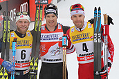 7th January 2018, Val di Fiemme, Fiemme Valley, Italy; FIS Cross Country World Cup, Tour de ski; Mens 9km F Pursuit; Martin Johnsrud Sundby (NOR), Dario Cologna (SUI), Alex Harvey (CAN) celebrate their podium positions
