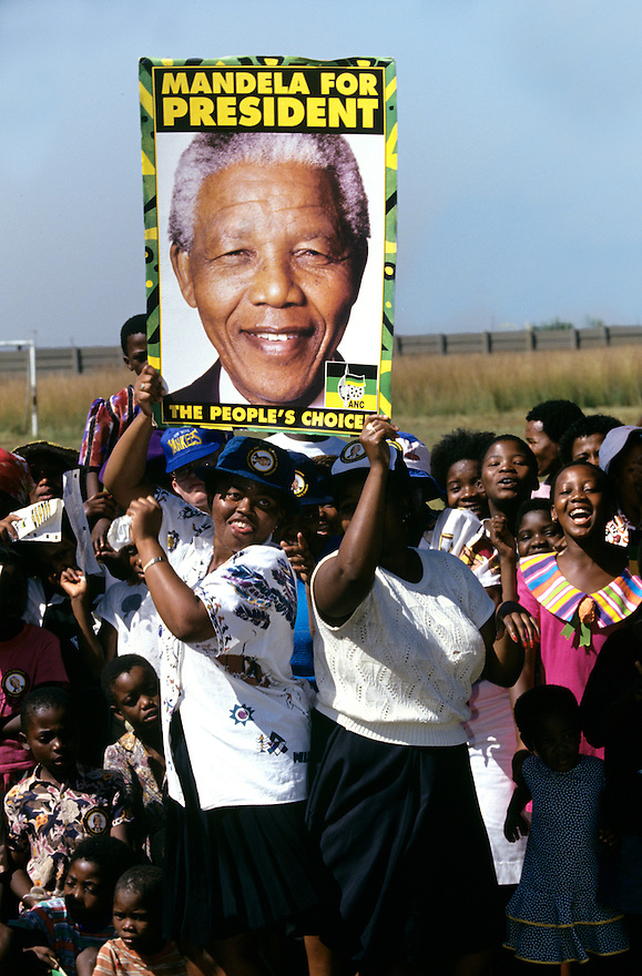 Supporters dance at a Nelson Mandela  campaign event.  After more then 27 years in jail as an anti-apartheid activist,   Nelson Mandela lead a 1994 campaign for President as a member of the African National Congress (ANC),  in the first free elections in South Africa in 1994.  Mandela has received more than 250 awards over four decades, including the 1993 Nobel Peace Prize..