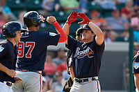 Atlanta Braves right fielder Gary Schwartz (57) is congratulated by Drew Lugbauer (97) after hitting a home run in the top of the eighth inning during a Grapefruit League Spring Training game against the Detroit Tigers on March 2, 2019 at Publix Field at Joker Marchant Stadium in Lakeland, Florida.  Tigers defeated the Braves 7-4.  (Mike Janes/Four Seam Images)