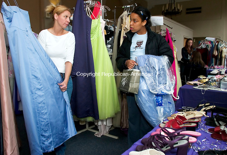 WATERBURY, CT- 15 APRIL 07- 041507JT14- <br /> Rita Welsh, left, gives Maytae Harge, 13, some tips on dress alterations at the Waterbury Youth Services' fourth annual Perfect Prom Project on Sunday at the agency. Gowns for the event were donated by Joyce's Bridal &amp; Formal Wear, Delianne Bridal &amp; Formal Wear, Great White Way, Ragtime Boutique, and Wedding Embassy among other private donors. Also featured were makeup demonstrations by Mary Kay representative Shauna Bowers, jewelry donated by Heather Jones, and flower arrangements donated by O'Rourke and Birch Florist.<br /> Josalee Thrift Republican-American