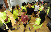 NWA Democrat-Gazette/ANDY SHUPE<br /> Students take part Wednesday, Aug. 5, 2015, in orientation for freshmen at Fayetteville High School. This is the first year for freshmen to attend school at the high school.