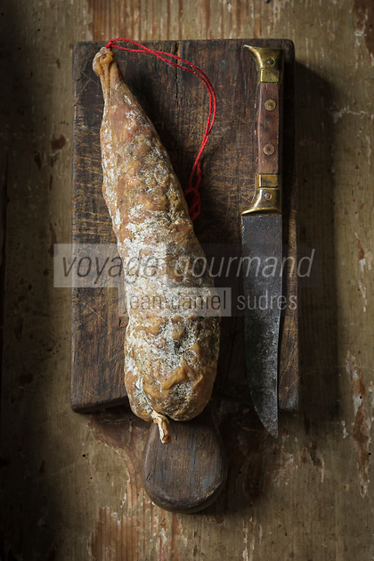 Europe, France, Auvergne, Cantal (15), Pierrefort:  Saucisson sec d'Auvergne en séchoir naturel à l'air libre - Yves Joffrois, Maison Joffrois, Boucherie charcuterie, Les Viandes Du Père Joffrois // Europe, France, Auvergne, Cantal, Pierrefort : Auvergne Dried sausage, natural drying in the open air -  Maison Joffrois,  Yves Joffrois