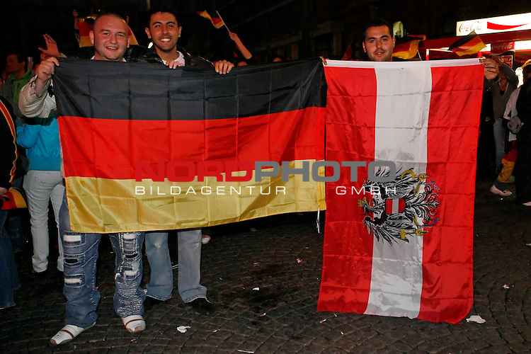 UEFA Euro 2008 Group B Fanmeile Bremen Match 20 <br /> <br /> &divide;sterreich ( AUT ) - Deutschland ( GER ) 0:1 (0:0)<br /> Austria vs. Germany<br /> <br /> Fanmeile und Public Viewing in Bremen.<br /> &divide;sterreich steht Kopf, zumindest die Fahne h&scaron;ngt nicht so wie es sich die &divide;sterreicher wŁnschen wŁrden.<br /> <br /> Foto &copy; nph (  nordphoto  ) *** Local Caption ***