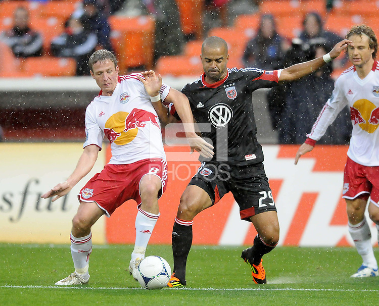 D.C. United forward Santos Maicon (29) goes against New York Red Bulls defender Jan Gunnar Solli (8)  D.C. United defeated The New York Red Bulls 4-1 at RFK Stadium, Sunday April 22, 2012.