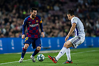 29th October 2019; Camp Nou, Barcelona, Catalonia, Spain; La Liga Football, Barcelona versus Real Valladolid; Lionel Messi takes on his defender against Valladolid - Editorial Use