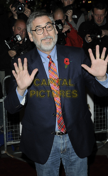 JOHN LANDIS .Attends the 'Burke and Hare' World Premiere at The Chelsea Cinema, Kings Road, Chelsea, London, England, UK, 25th October 2010..half length jeans blazer  glasses red tartan plaid tie black navy blue jacket shirt poppy beard facial hair hands funny gesture .CAP/CAN.©Can Nguyen/Capital Pictures.