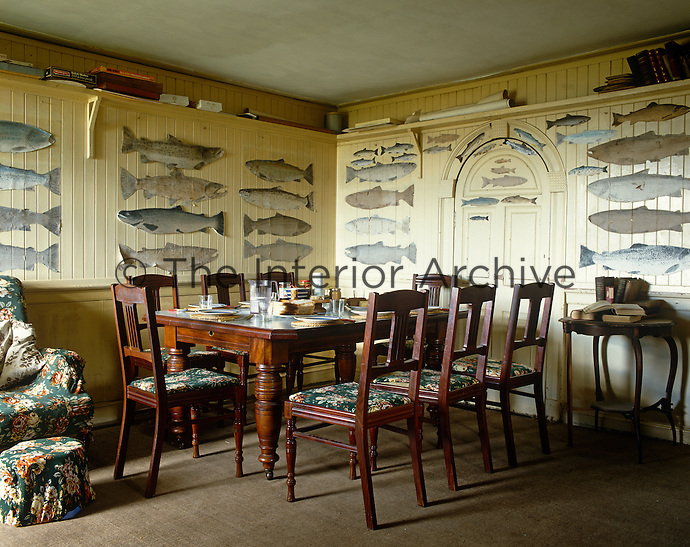 The walls of the dining room at the fishing lodge are decorated with paper cutouts of salmon