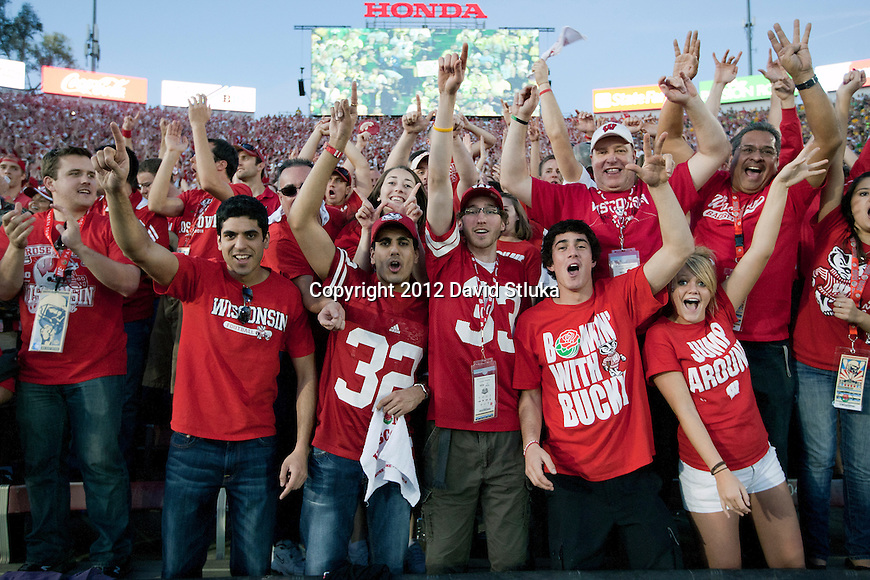 "Wisconsin Badgers fans dance to the song ""Jump Around"" after the 3rd quarter during the 2012 Rose Bowl NCAA football game against the Oregon Ducks in Pasadena, California on January 2, 2012. The Ducks won 45-38. (Photo by David Stluka)"