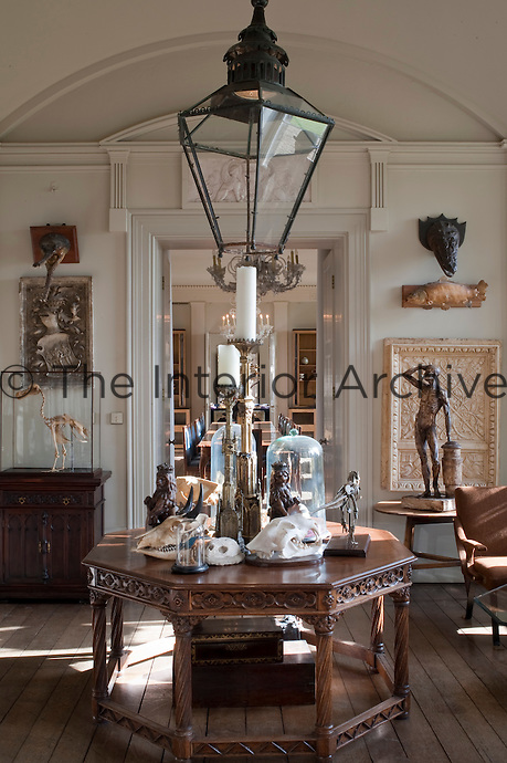 Carefully arranged displays of sculls, glass domes, sculpture and boxes adorn each room