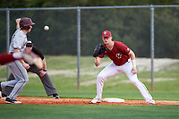 Boston College Eagles first baseman Mitch Bigras (4) stretches for a pickoff attempt throw as Cole McDevitt (10) gets back to the bag during a game against the Minnesota Golden Gophers on February 23, 2018 at North Charlotte Regional Park in Port Charlotte, Florida.  Minnesota defeated Boston College 14-1.  (Mike Janes/Four Seam Images)