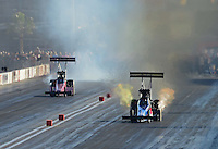 Oct. 27, 2012; Las Vegas, NV, USA: NHRA top fuel driver Cory McClenathan (right) races alongside Terry McMillen during qualifying for the Big O Tires Nationals at The Strip in Las Vegas. Mandatory Credit: Mark J. Rebilas-