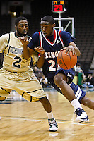 February 03, 2011:    Belmont Bruins guard Ian Clark (21) dribbles around Jacksonville Dolphins guard Russell Powell (2) during Atlantic Sun Conference action between the Jacksonville Dolphins and the Belmont Bruins at Veterans Memorial Arena in Jacksonville, Florida.  Belmont defeated Jacksonville 76-70.