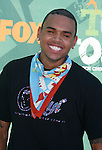 Singer Chris Brown arrives at the 2008 Teen Choice Awards at the Gibson Amphitheater on August 3, 2008 in Universal City, California.