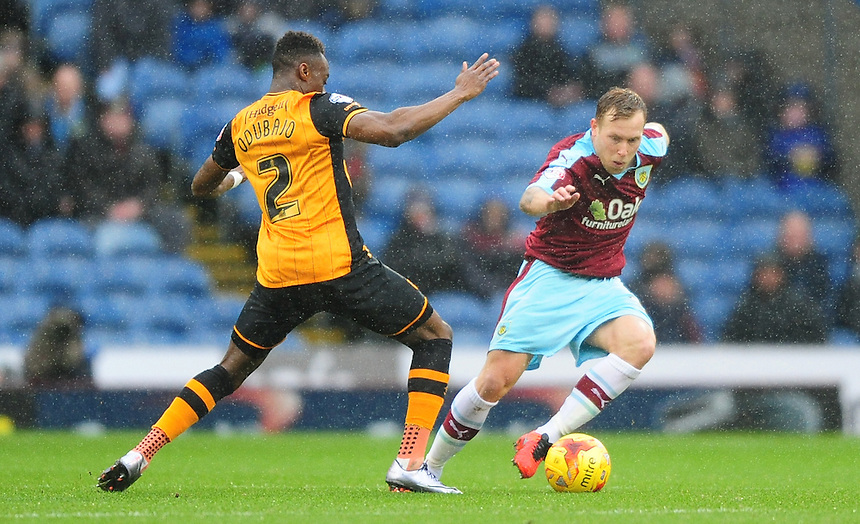Burnley's Scott Arfield vies for possession with Hull City&rsquo;s Moses Odubajo<br /> <br /> Photographer Chris Vaughan/CameraSport<br /> <br /> Football - The Football League Sky Bet Championship - Burnley v Hull City - Saturday 6th February 2016 - Turf Moor - Burnley <br /> <br /> &copy; CameraSport - 43 Linden Ave. Countesthorpe. Leicester. England. LE8 5PG - Tel: +44 (0) 116 277 4147 - admin@camerasport.com - www.camerasport.com