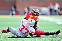 Terrapins' Brando Ross is tackled from behind by Buckeyes' Joshua Perry. Ohio State trounced Maryland 52-24 during a game at the Capital One Field in Byrd Stadium, College Park, MD on Saturday, October 4, 2014.  Alan P. Santos/DC Sports Box