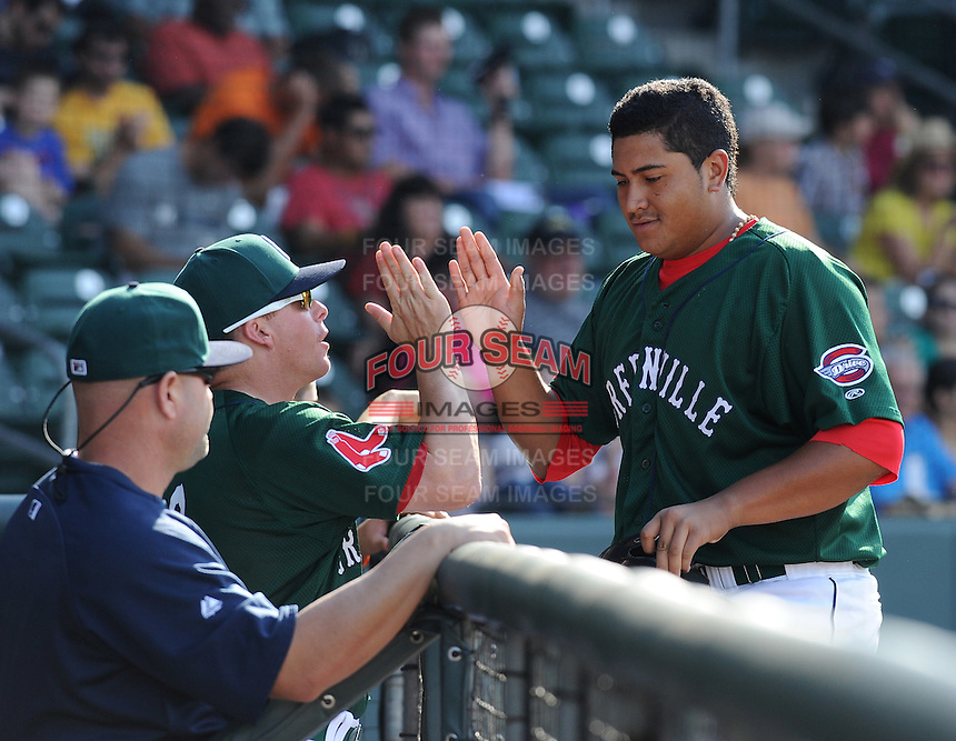 First baseman Boss Moanaroa (29) of the Greenville Drive is congratulated in the dugout after hitting a home run in a game against the Rome Braves on May 6, 2012, at Fluor Field at the West End in Greenville, South Carolina. Greenville won, 11-3. (Tom Priddy/Four Seam Images)