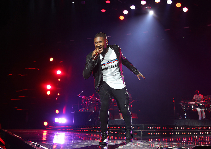 Usher is seen in the pressroom at 2015 Essence Music Festival Concert at Superdome on Saturday, July 4, 2015 in New Orleans, LA. (Photo by Donald Traill/Invision/AP)