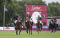 Marcos Di Paola (King Power) heads towards goal during the Cartier Queens Cup Final match between King Power Foxes and Dubai Polo Team at the Guards Polo Club, Smith's Lawn, Windsor, England on 14 June 2015. Photo by Andy Rowland.