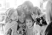 Gerry Mabin and kids having their photo taken, Julian's Primary School, Streatham, London.  1971.  Gerry later moved to Toronto, Canada, where she founded the Mabin School in 1980.