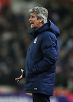 Manuel Pellegrini manager of Manchester City shouts instructions - Barclays Premier League - Stoke City vs Manchester City - Britannia Stadium - Stoke on Trent - England - 11th February 2015 - Picture Simon Bellis/Sportimage
