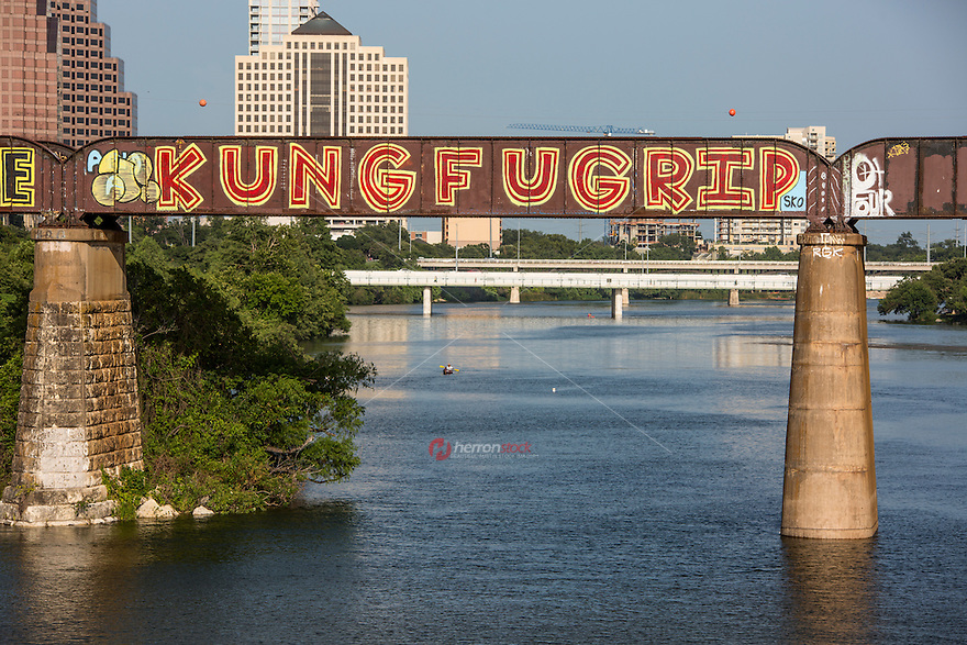 "The ""KUNG FU GRIP"" is a famous and creative public art mural painting on the Austin Railroad Graffiti Bridge over Lady Bird Lake, Austin, Texas."