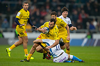 24th November 2019; AJ Bell Stadium, Salford, Lancashire, England; European Champions Cup Rugby, Sale Sharks versus La Rochelle; Alexi Bales of La Rochelle is tackled by AJ MacGinty of Sale Sharks - Editorial Use