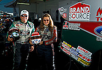 Sept. 19, 2010; Concord, NC, USA; NHRA funny car drivers John Force (left) and daughter Ashley Force Hood pose for a portrait during the O'Reilly Auto Parts NHRA Nationals at zMax Dragway. Mandatory Credit: Mark J. Rebilas for ESPN the Magazine