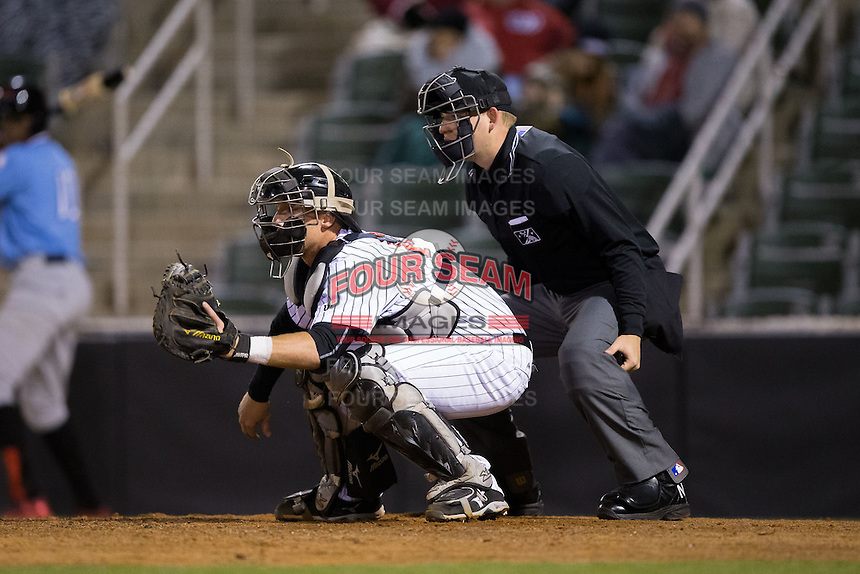 Kannapolis Intimidators catcher Casey Schroeder (10) sets a target as home plate umpire Ryan Powers looks on during the game against the Hickory Crawdads at Kannapolis Intimidators Stadium on April 9, 2016 in Kannapolis, North Carolina.  The Crawdads defeated the Intimidators 6-1 in 10 innings.  (Brian Westerholt/Four Seam Images)