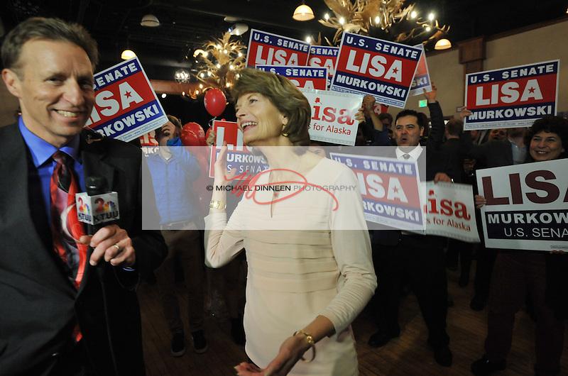 U.S. Sen. Lisa Murkowski, R-Alaska, center, reacts to news of her apparent re-election in Anchorage Alaska, Tuesday, November 8, 2016.  (AP Photo/Michael DInneen)