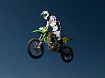 I went to a motocross race in Colorado Springs. I shot a bunch of pictures of the bikes racing each other. I used a Elinchrome strobe to turn daylight into night and also some off camera flashes-Canon 580 EXII.