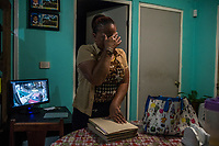 Vicky Delgadillo cries after having flipped through a photo album of her missing daughter Yunery Citlally at her home in Xalapa, Mexico on November 4, 2017. <br /> Photo Daniel Berehulak for The New York Times