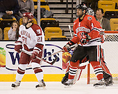 Alex Meintel (Harvard - 21), Jacques Perreault (NU - 9) - The Northeastern University Huskies defeated the Harvard University Crimson 3-1 in the Beanpot consolation game on Monday, February 12, 2007, at TD Banknorth Garden in Boston, Massachusetts.