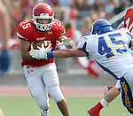 SIOUX FALLS, SD - SEPTEMBER 7:  Caden Quintanilla #25 from Lincoln looks to shake the grasp of Matt White #45 from O'Gorman in the first quarter of their game at the 2013 Presidents Bowl at Howard Wood Field. (Photo by Dave Eggen/Inertia)