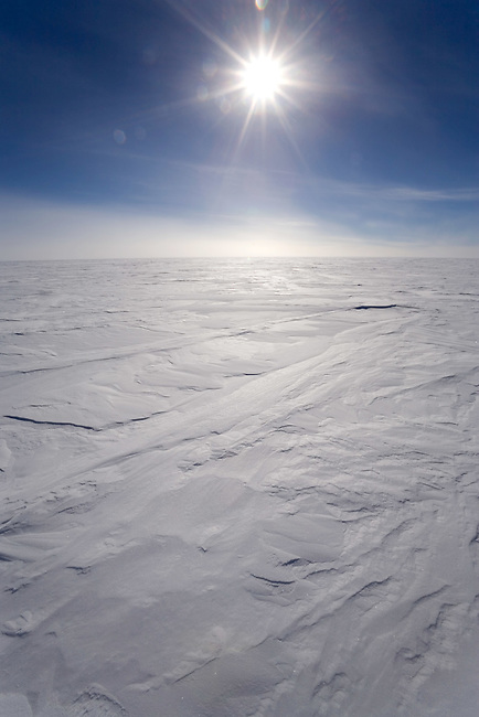 Sun shining over the Polar Plateau at 89 degrees South. Antarctica.
