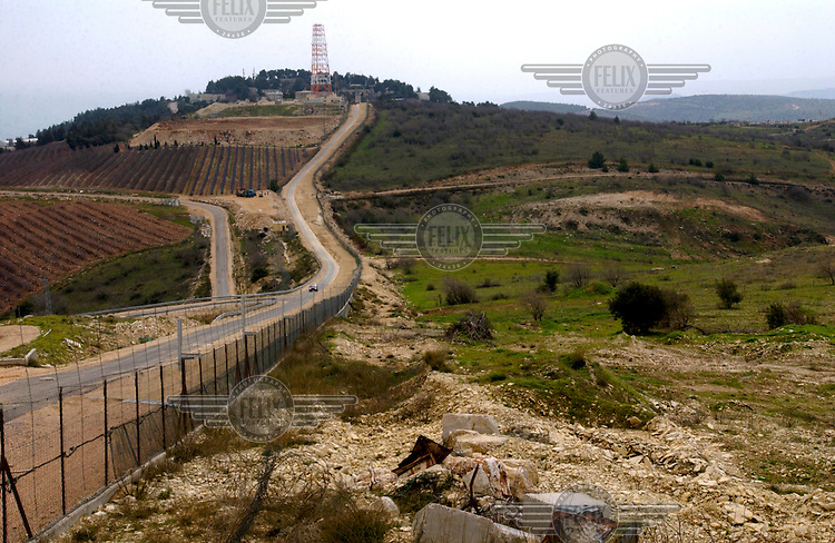 ©Kael Alford/Panos Pictures..LEBANON Israeli border  03/2003..The UN-demarcated blue line in the south of Lebanon, the new border between Israel and Lebanon as of May 2000. Israel occupied southern Lebanon from 1982 until 2000, when they withdrew after relentless resistence from Hizbollah fighters.