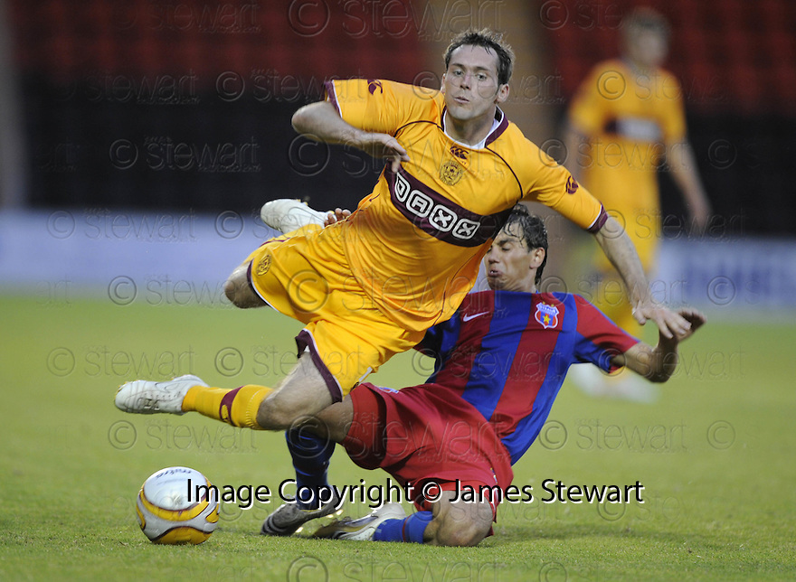 06/08/2009  Copyright  Pic : James Stewart.sct_25_motherwell_v_steaua_bucharest  .JIM O'BRIEN IS BROUGHT DOWN BY ANDREI IONESCU.James Stewart Photography 19 Carronlea Drive, Falkirk. FK2 8DN      Vat Reg No. 607 6932 25.Telephone      : +44 (0)1324 570291 .Mobile              : +44 (0)7721 416997.E-mail  :  jim@jspa.co.uk.If you require further information then contact Jim Stewart on any of the numbers above.........