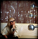 Barbara Hulanicki, a multidimensional artist, poses in the Lucite Suite at the Kent Hotel formerly owned by Chris Blackwell of Island Records on South Beach. Hulanicki is the interior designer of the Marlin, Kent and Netherland Hotel in Miami Beach.