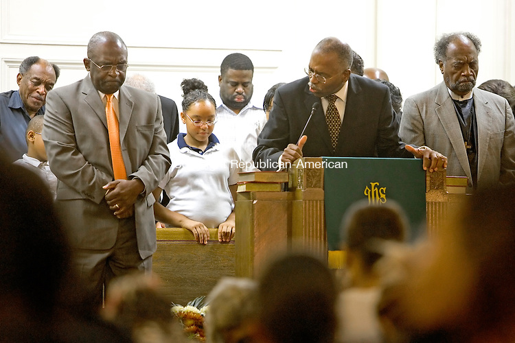 WATERBURY, CT-- 18 OCTOBER 2007--101807JS18-The Rev. Herman Franklin, left, bous his head during prayer by Rev. Larry C. Green, pastor at the Grace Baptist Church in Waterbury on Thursday night. Rev. Franklin, who along with his wife and several family members, fled hurricane Katrina, will be returning to New Orleans. <br /> Jim Shannon / Republican-American