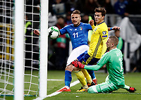 Soccer Football - 2018 World Cup Qualifications - Europe - Italy vs Sweden - San Siro, Milan, Italy - November 13, 2017 <br /> Italy's Ciro Immobile (l) in action with Sweden's goalkeeper Robin Olsen (r) and Victor Lindelof (c) during the FIFA World Cup 2018 qualification football match between Italy and Sweden at the San Siro Stadium in Milan on November 13, 2017.<br /> UPDATE IMAGES PRESS/Isabella Bonotto