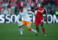 07 May 2011: Houston Dynamo midfielder Lovel Palmer #22 and Toronto FC midfielder Tony Tchani #22 in action during an MLS game between the Houston Dynamo and the Toronto FC at BMO Field in Toronto, Ontario..Toronto FC won 2-1.