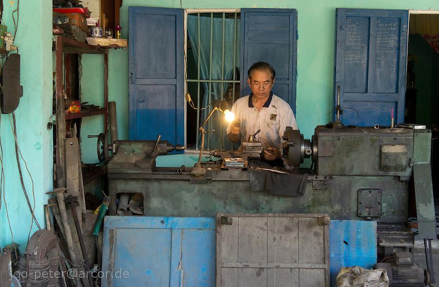 man working in his metalworkshop,  city Hoi An, Vietnam