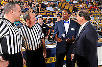 25 February 2012:  FIU Head Coach Isiah Thomas, South Alabama Head Coach Ronnie Arrow, and officials speak prior to the game.  The FIU Golden Panthers defeated the University of South Alabama Jaguars, 81-74, at the U.S. Century Bank Arena in Miami, Florida.