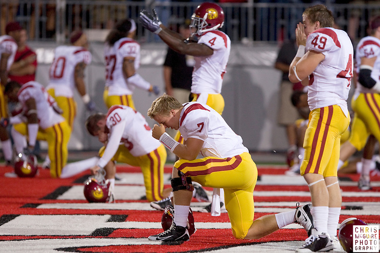 12 September 2009:  Football -- USC quarterback Matt Barkley prays before his game against Ohio State at Ohio Stadium in Columbus.  USC won 18-15.  Photo by Christopher McGuire.