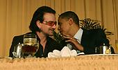 Rock singer, activist Bono, left, and United States Senator Barack Obama (Democrat of Illinois), right, speak at the National Prayer Breakfast in Washington,DC on February 2, 2006.  <br /> Credit: Dennis Brack - Pool via CNP