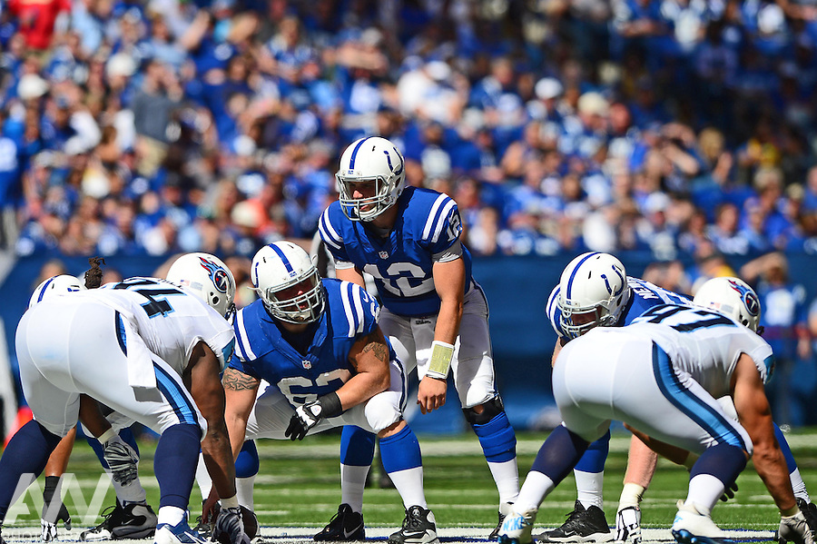 Sep 28, 2014; Indianapolis, IN, USA; Indianapolis Colts quarterback Andrew Luck (12) takes a snap from center during the third quarter against the Tennessee Titans at Lucas Oil Stadium. Colts defeated the Titans 41-17. Mandatory Credit: Andrew Weber-USA TODAY Sports