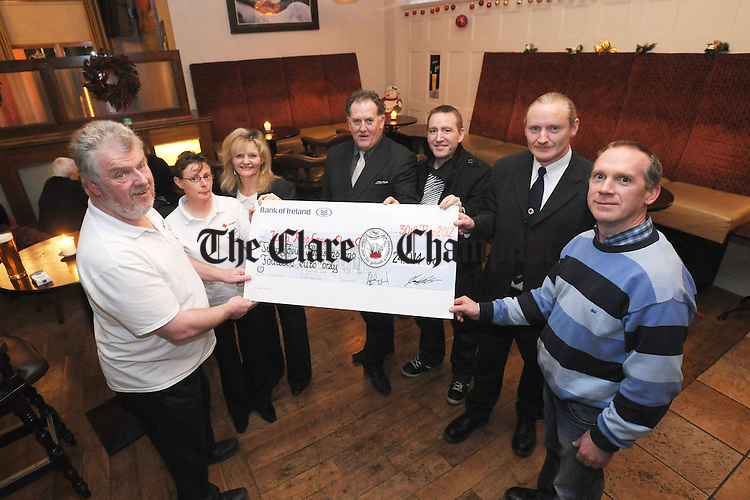 James Lafferty, Bridget O' Leary and Shirley Benson from the Irish Red Cross present the cheque to Pat O' Connell, Colin Ahern, Ciaran Meehan and Michael Mc Mahon from the Clare area committee, proceeds raised from the Mount Callan Challenge. Photograph by Declan Momnaghan