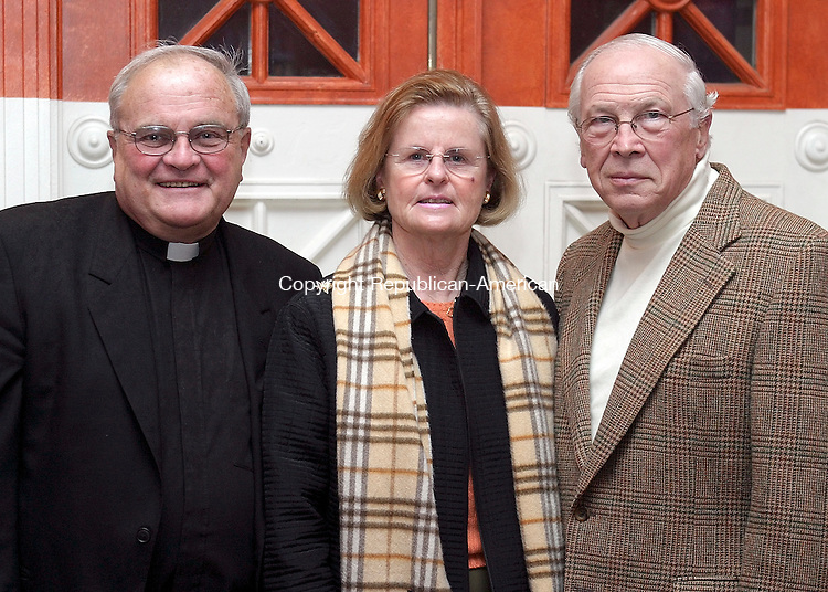 WATERBURY, CT - 31 March 2004 - 033104TH03 - Monsignor James Coleman of St. Peter and Paul Church in Waterbury and Sacred Heart Class of '54, Ben Benson (Class of '50) and Rosanne Benson of Greenwich, administrators of the Dr. John F. Somma Memorial Scholarship, pose at the preview party for the Sacred Heart High School Spring Musical preview party at the Mattatuck Museum in Waterbury.   TODD HOUGAS PHOTO